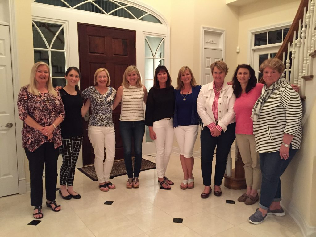 Image of Friends of Epworth standing in front foyer or house